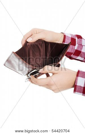 Casual woman showing her empty wallet. Isolated on white.