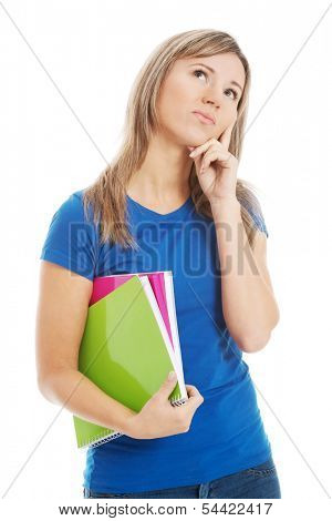 Young casual student holding workbook and thinking.  Isolated on white.