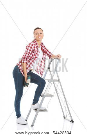 Young woman on step ladder. Isolated on white.