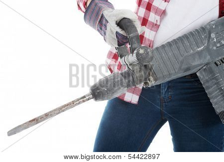 Casual woman holding jackhammer. Isolated on white.