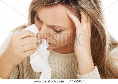 Young woman with tissues crying/ having runny nose. Isolated on white.