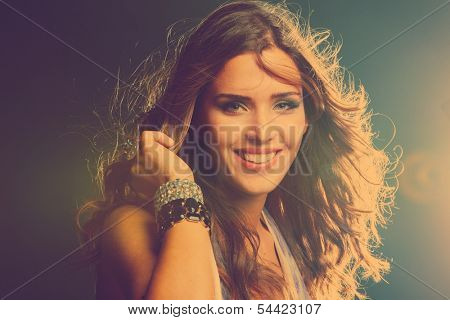 smiling young girl dancing in night club close up