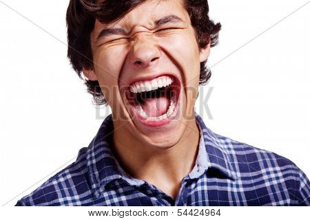 Close up portrait of loudly screaming young man isolated on white background