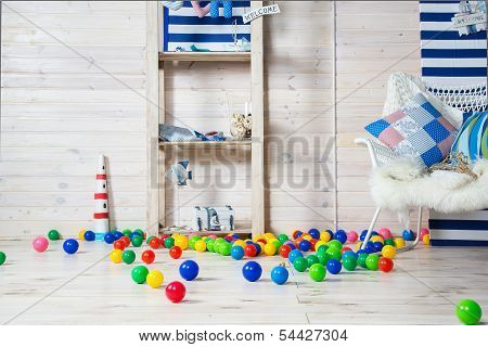 Nursery With Colorful Toys And Balls