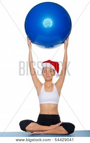 Asian Girl Sitting With A Ball Over His Head