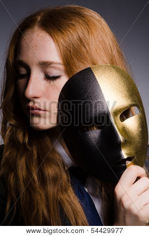 Woman with mask in hypocrisy concept