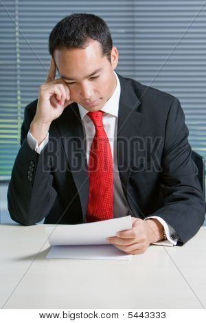 Smart Eurasian Business Man Browsing Documents