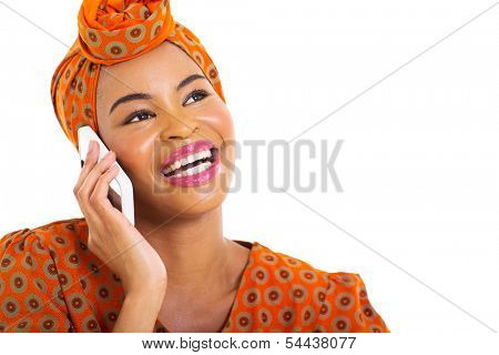 beautiful young african woman talking on her cell phone over white background