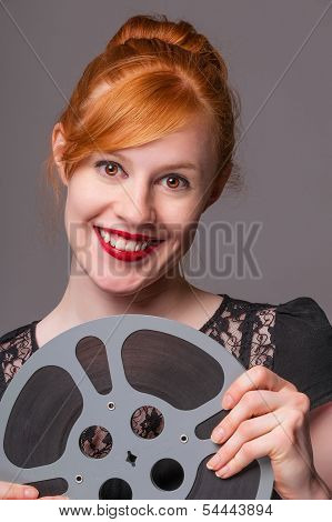 Attractive Redhead Holding Film Reel