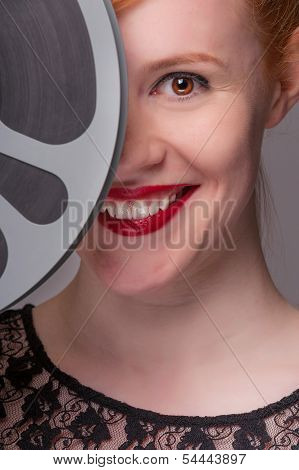 Attractive Redhead With Film Reel