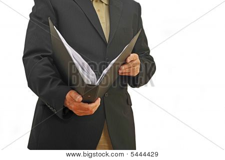 Businessman Holding Folder In Front Of Himself
