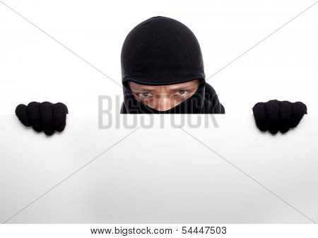 Robber hiding behind a empty white sign with space for text