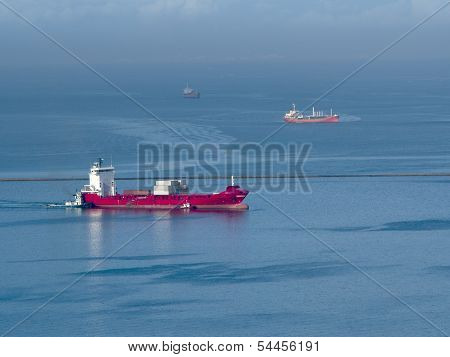 big red ship in the sea