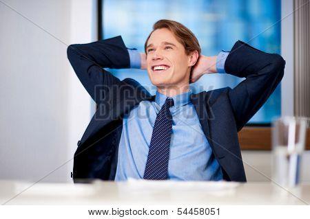 Smiling Young Businessman Thinking Something
