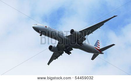 American Airlines Boeing 777 in New York sky before landing at JFK Airport
