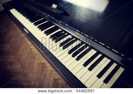 Retro piano. Detail, toned.