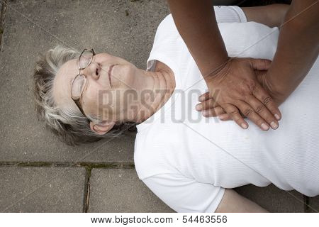 An Old Woman Receiving Firs Aid