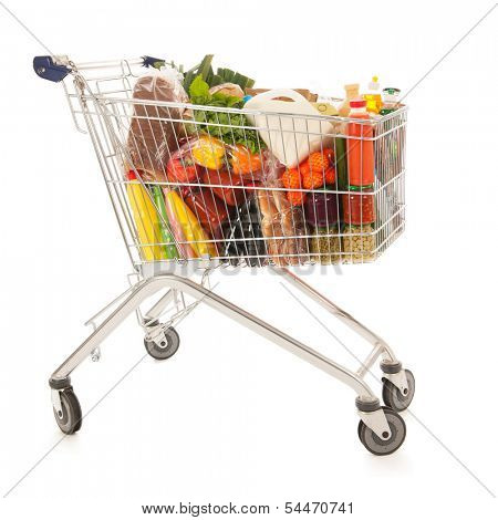Shopping cart full with dairy grocery products isolated over white background