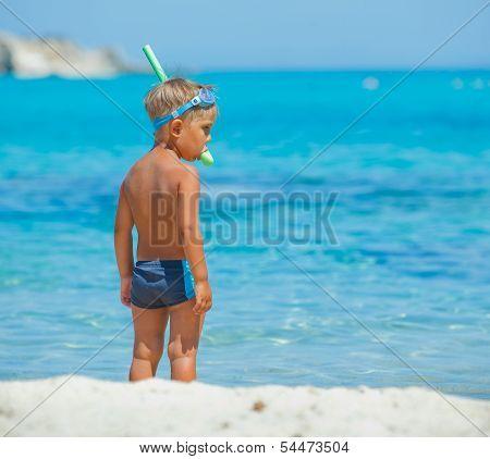 Cute boy snorkelling
