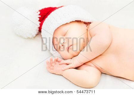 Adorable Sleeping Newborn Baby Wearing Santa Claus Hat, Christmas, New Year