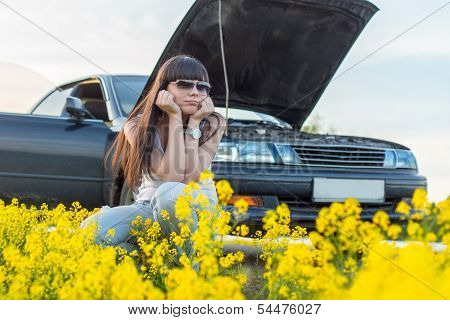 Girl Is Bored Near The Broken Car