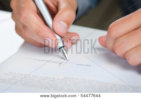 Close Up Of A Businessman Signing Contract