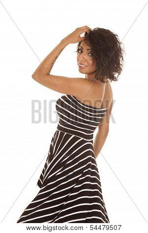 Hispanic Woman Striped Dress Back Look