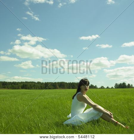 Beautiful Young Woman On A Green Field