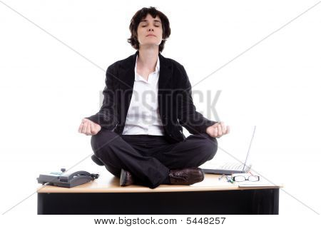 Business Woman Doing Yoga On Her Desk