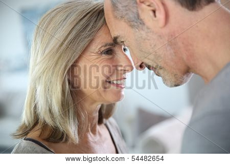 Loving senior couple looking at each other's eyes