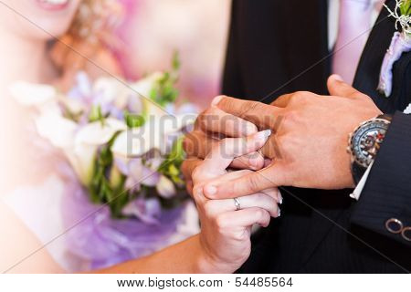 The Bride Dresses A Wedding Ring To The Groom