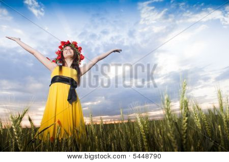 Young Girl In The Wheat Field