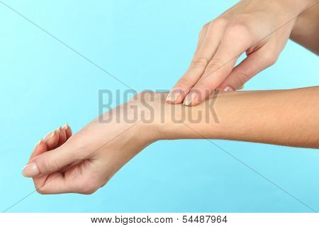 Measuring  pulse on light blue background