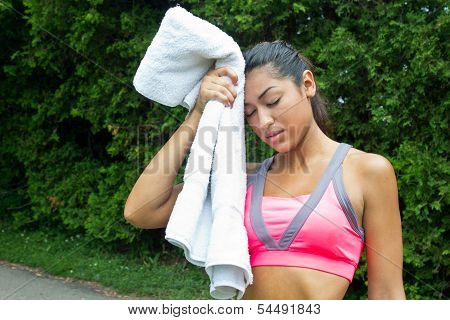 Woman Towels Off And Rests After Running