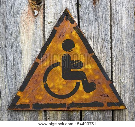 Disabled Icon on Rusty Warning Sign.