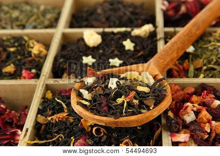 assortment of dry tea in wooden box, close up