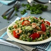 stock photo of tabouleh  - Tabbouleh salad with quinoa salmon tomatoes cucumbers and parsley