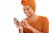 foto of traditional attire  - gorgeous african american woman using smart phone on white background - JPG