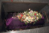 picture of crematory  - A coffin in a morgue with a flower arrangement - JPG