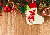 Christmas decorations and sock on wood background. Beautiful Christmas card.