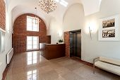 stock photo of elevator  - Reception in the classic hotel and an elevator - JPG