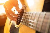 image of fret  - Female hand playing on acoustic guitar - JPG