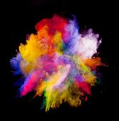 stock photo of explosion  - Freeze motion of colored dust explosion isolated on black background - JPG