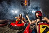 stock photo of karts  - girl is driving Go - JPG