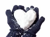 stock photo of freezing temperatures  - Woman with glove on forming snow heart - JPG