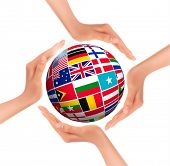 picture of flags world  - Hands holding globe with flags of world - JPG