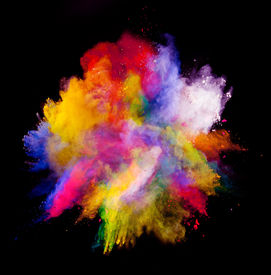 stock photo of freezing  - Freeze motion of colored dust explosion isolated on black background - JPG