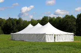 stock photo of canopy roof  - large white wedding or events tent in the green grass field - JPG