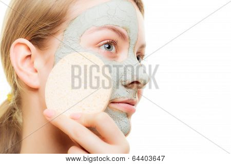 Skin Care. Woman Removing Clay Mud Facial Mask