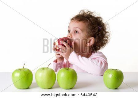 Little Girl Eating A Red Apple